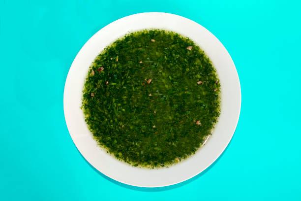 Molokhia soup on blue background stock photo