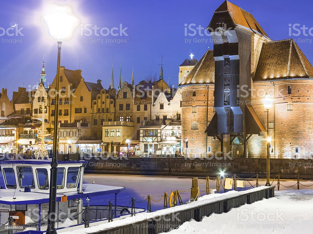 Moltawa river and the crane Gdansk Poland. Winter night scenery stock photo
