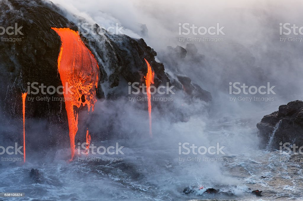 Molten Lava dripping into the ocean Lava from the Kilauea Volcano eruption in Hawaii entering the pacific ocean Beach Stock Photo