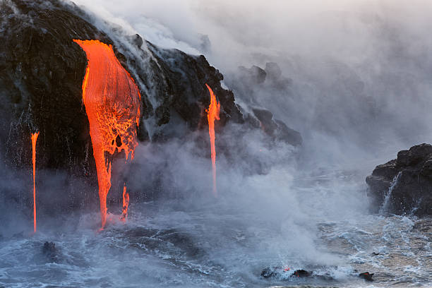 Molten Lava dripping into the ocean Lava from the Kilauea Volcano eruption in Hawaii entering the pacific ocean lava stock pictures, royalty-free photos & images