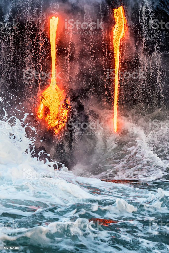 Molten lava flowing into the Pacific Ocean on Big Island stock photo