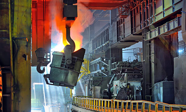 molten metal in ladle - metallurgy stock photos and pictures
