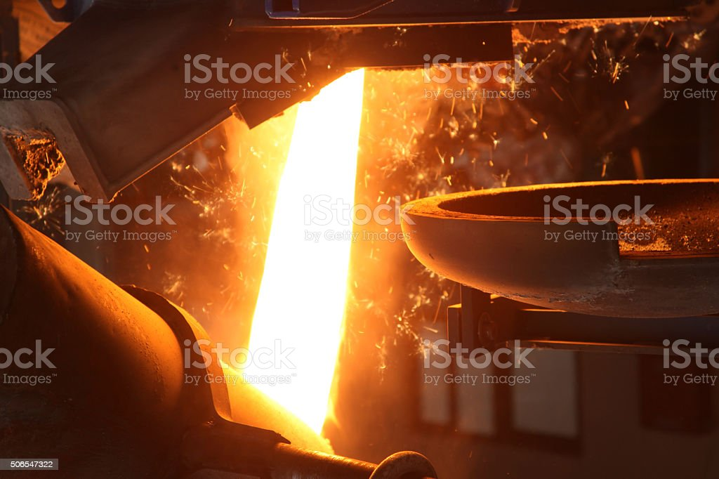 Molten Metal Poured at Foundry stock photo