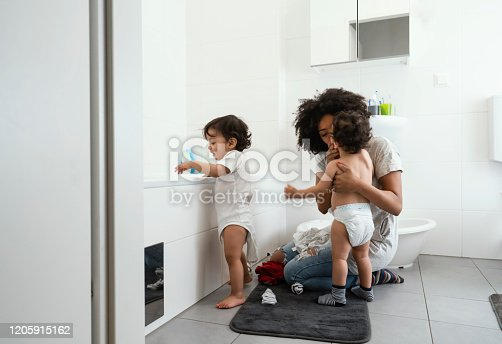 Single mother with baby twins at home