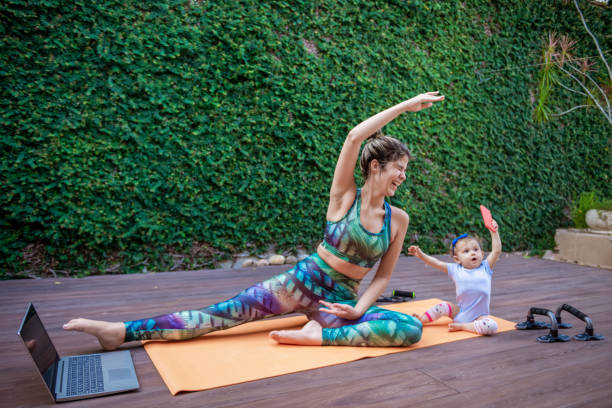 mom and baby exercise together - exercise at home stock pictures, royalty-free photos & images