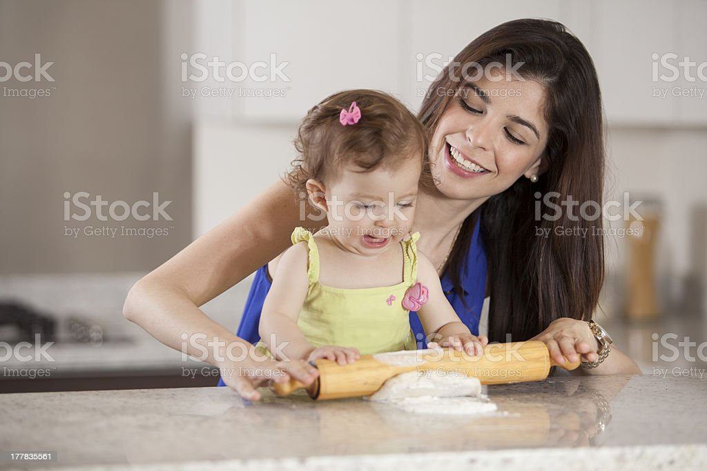 Mom and baby girl cooking royalty-free stock photo