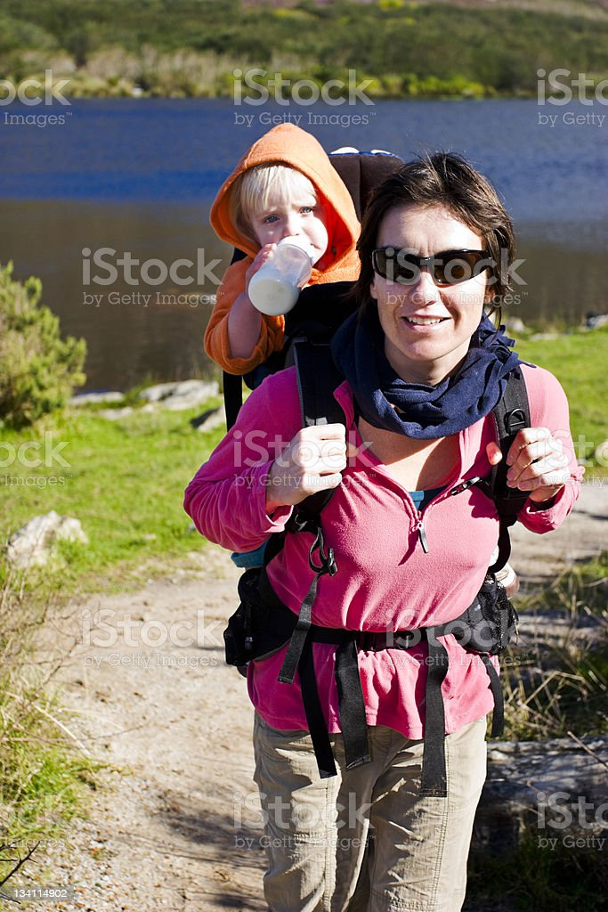 Mom and baby hiking royalty-free stock photo