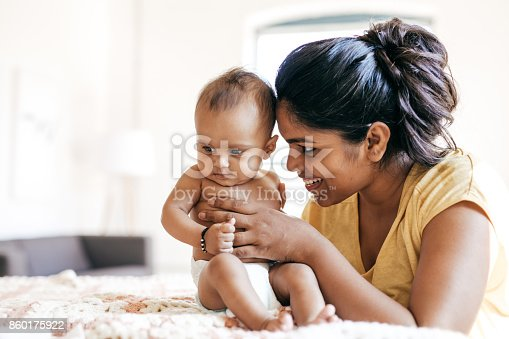 istock Mom and baby indoor 860175922
