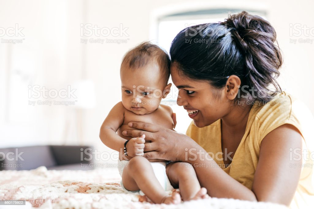 Mom and baby indoor stock photo