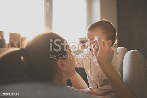 466231012istockphoto Mom and baby on the couch 509801790