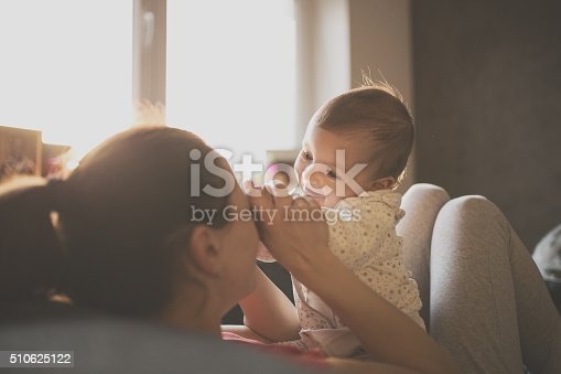 istock Mom and baby on the couch 510625122