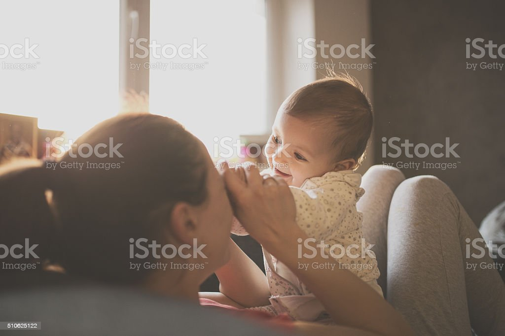 Mom and baby on the couch stock photo