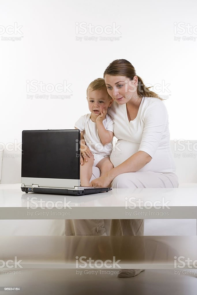 Mom and baby using laptop royalty-free stock photo