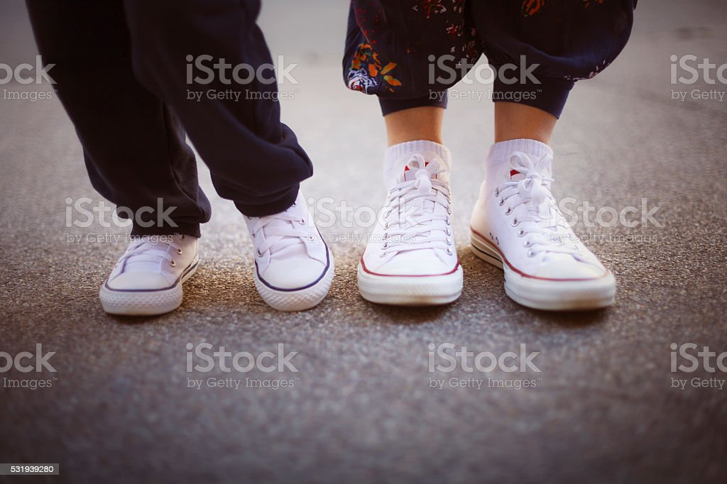 Mom and boy wearing sneakers stock photo