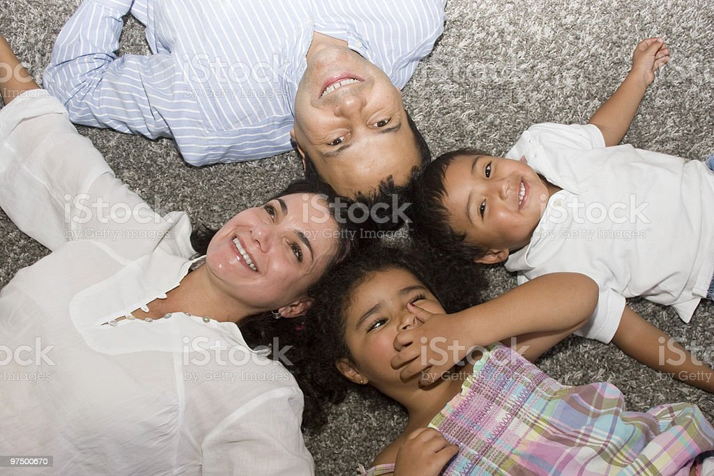 Mom and dad playing with their children royalty-free stock photo