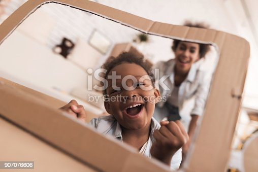 496487362 istock photo Mom and daughter are playing with big toy cars. 907076606