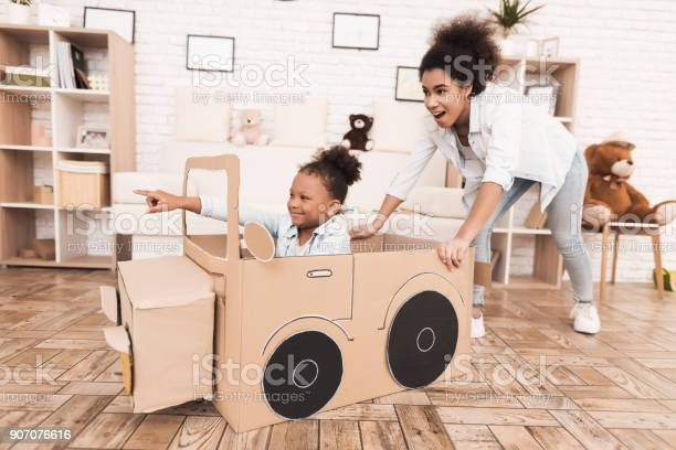 Mom and daughter are playing with big toy cars picture id907076616?b=1&k=6&m=907076616&s=612x612&h=t5glslanftj8fkzdshla7 yl0y9ljmfraicogglmpcw=