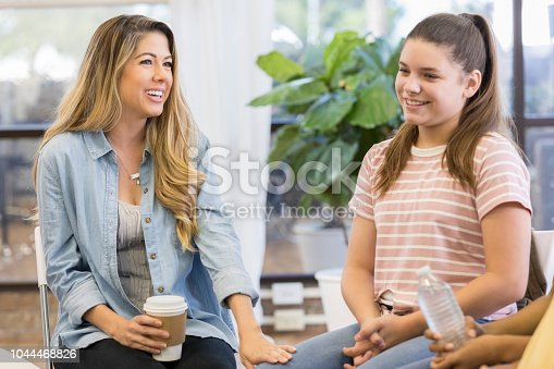 1055095320 istock photo Mom and daughter attend support group 1044468826