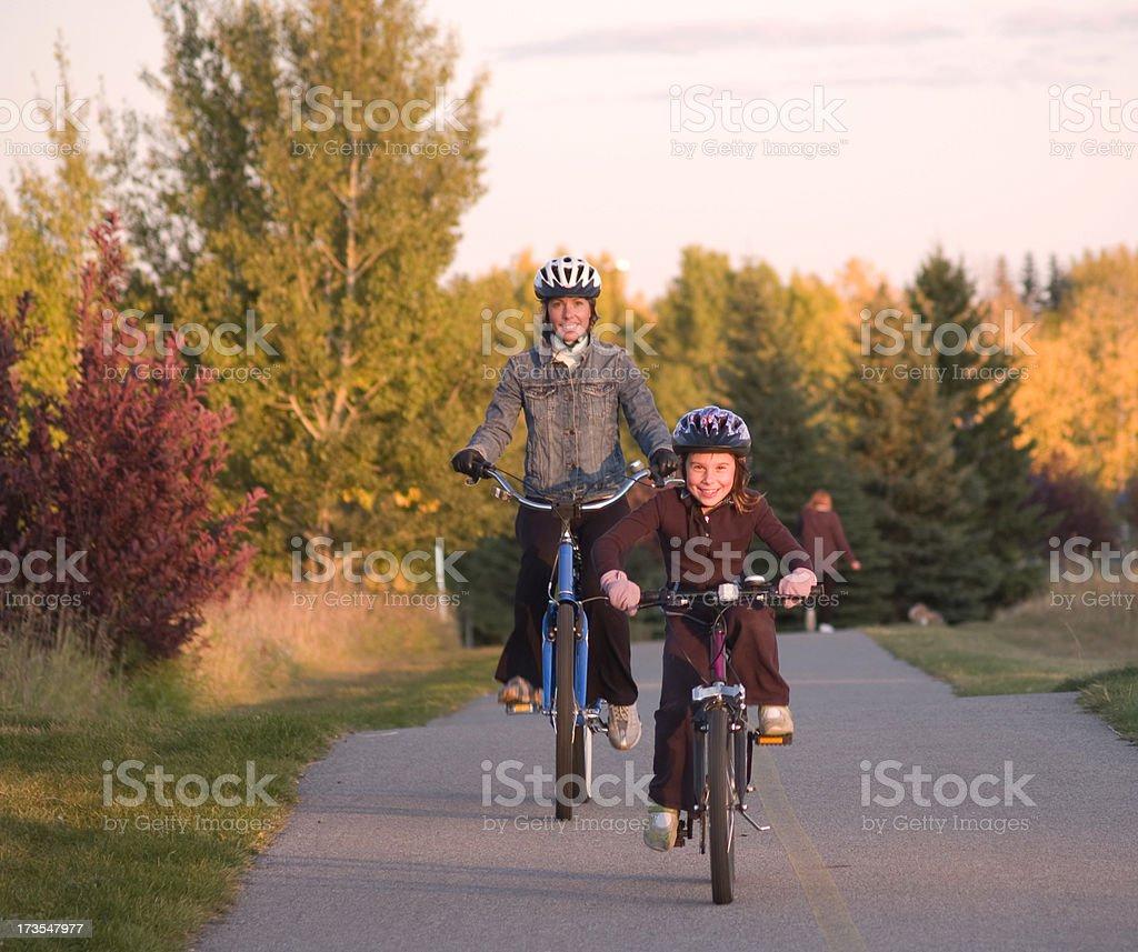 Mom and daughter biking royalty-free stock photo