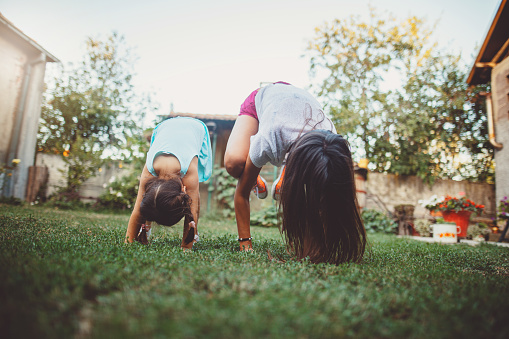 Mom And Daughter Doing Yoga Outdoors Stock Photo - Download Image Now