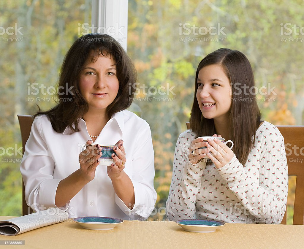 Mom and Daughter Drinking Coffee royalty-free stock photo