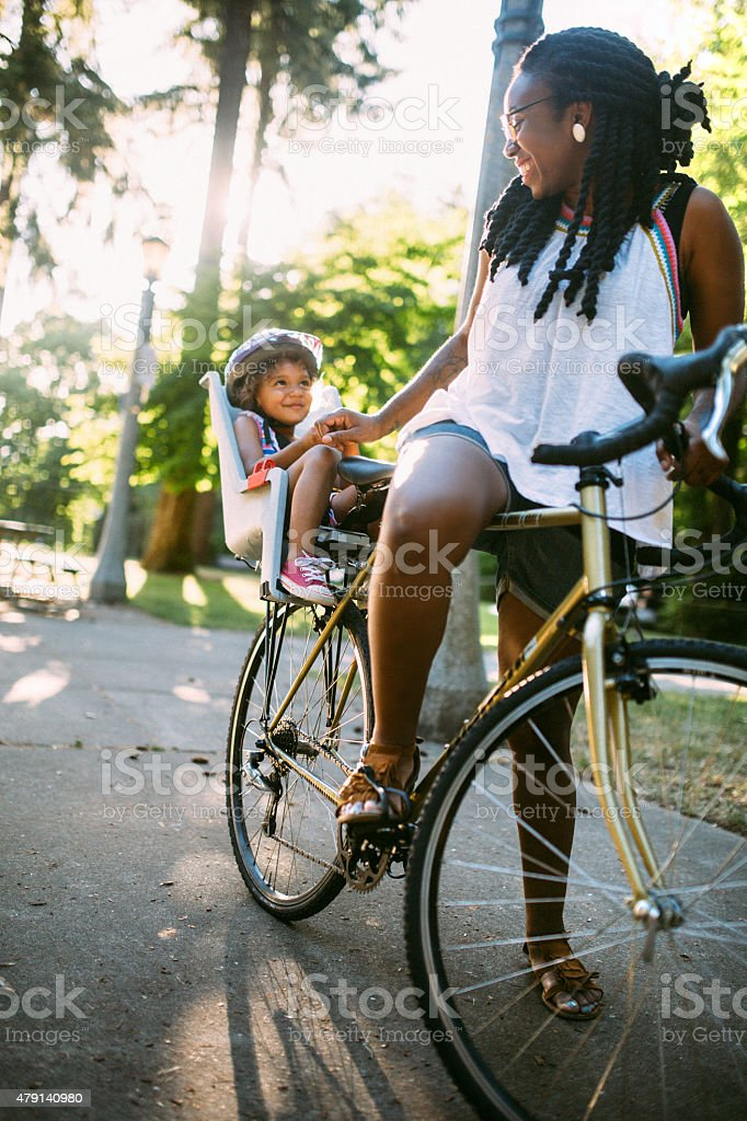 Mom and Daughter Enjoy a Bike Ride stock photo