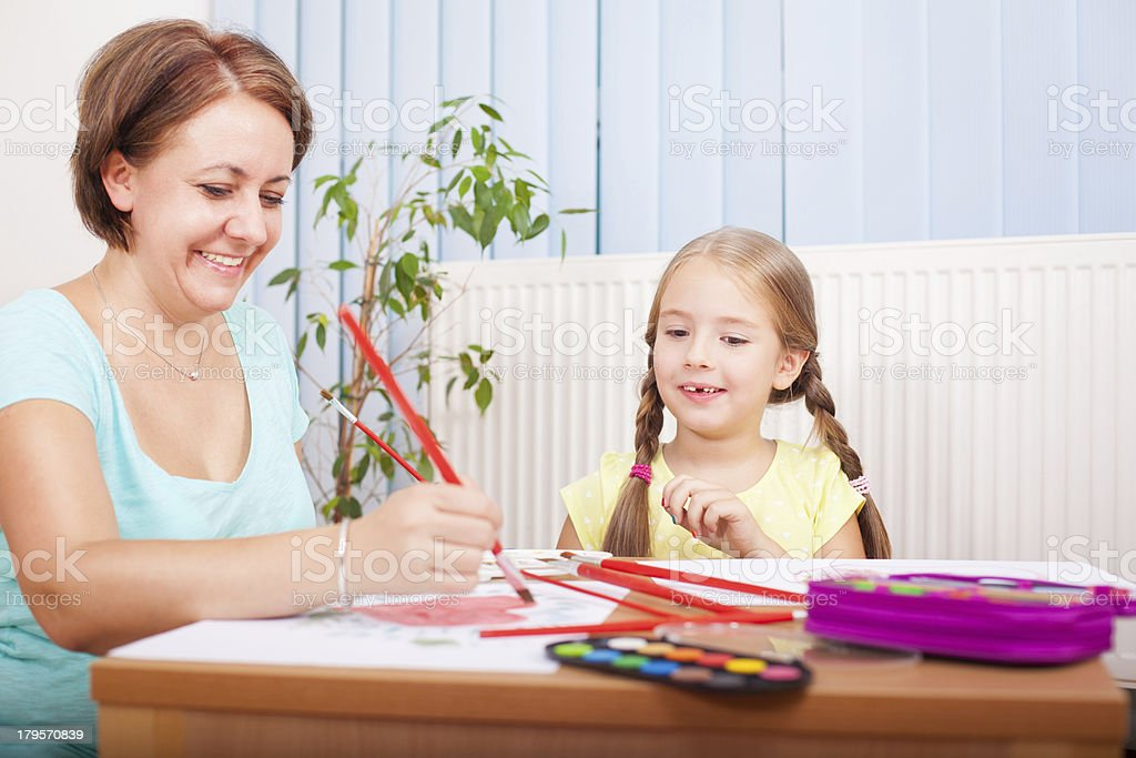 Mom and daughter have fun stock photo
