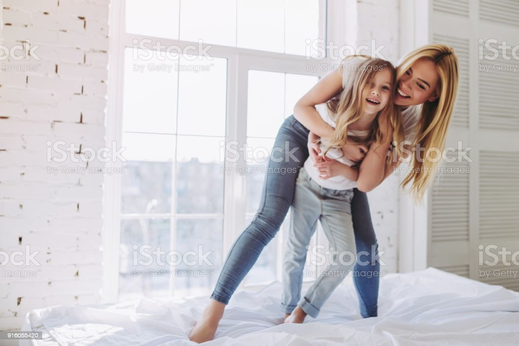 Mom and daughter having fun at home stock photo