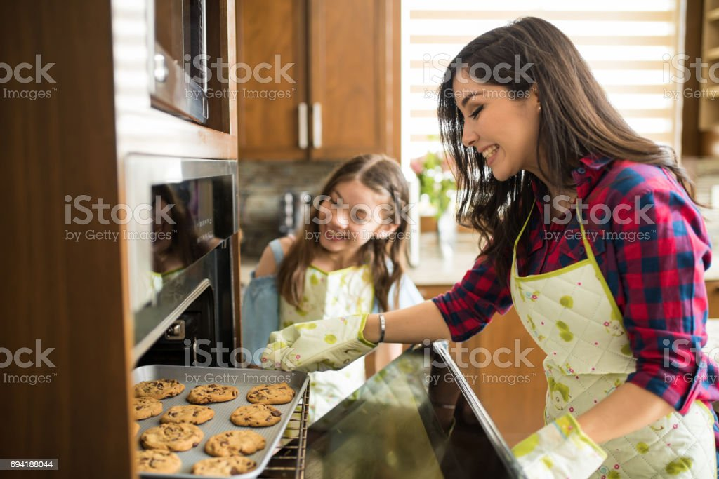 Mom and daughter just baked some cookies stock photo