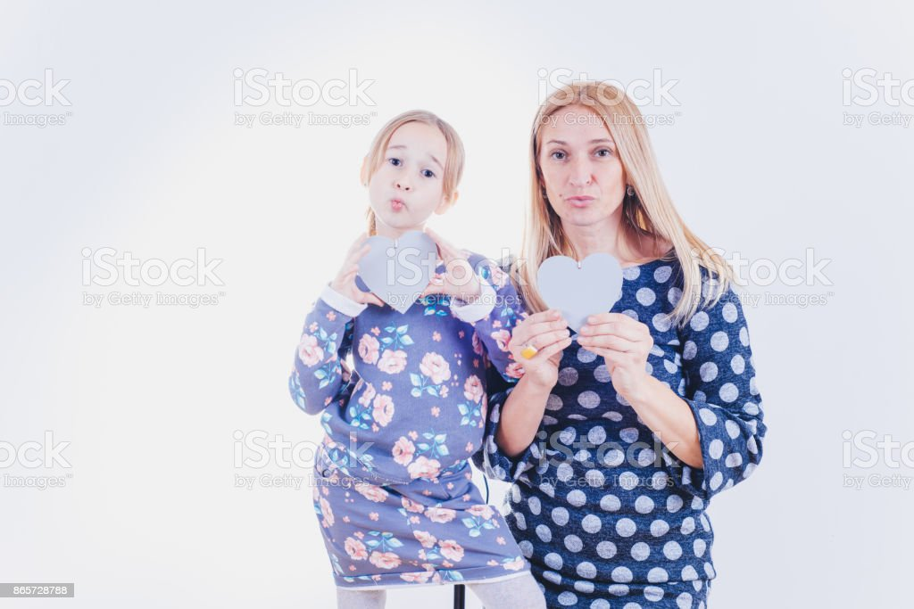 Mom and daughter on a white background stock photo