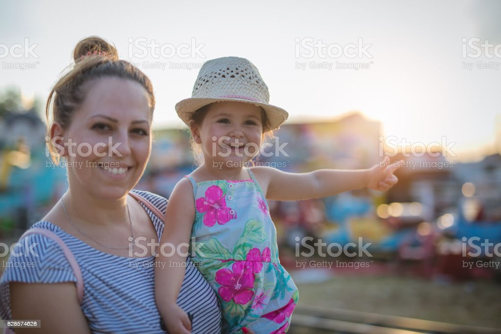 Mom and daughter on the fair stock photo