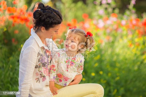 480122543 istock photo Mom and daughter playing, hugging and smiling. 1214687256