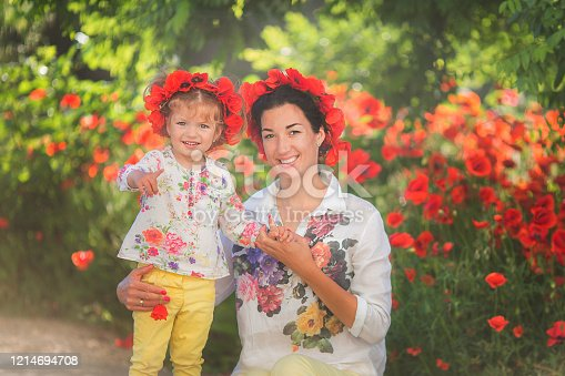 480122543 istock photo Mom and daughter playing, hugging and smiling. 1214694708