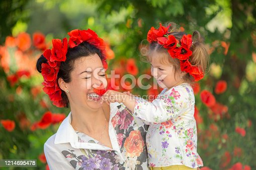 480122543 istock photo Mom and daughter playing, hugging and smiling. 1214695478