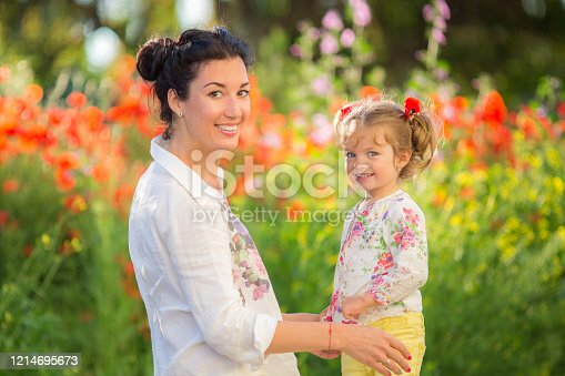 480122543 istock photo Mom and daughter playing, hugging and smiling. 1214695673