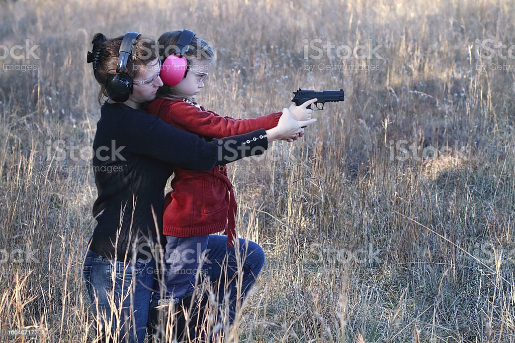 Mom and Daughter Practicing Shooting stock photo