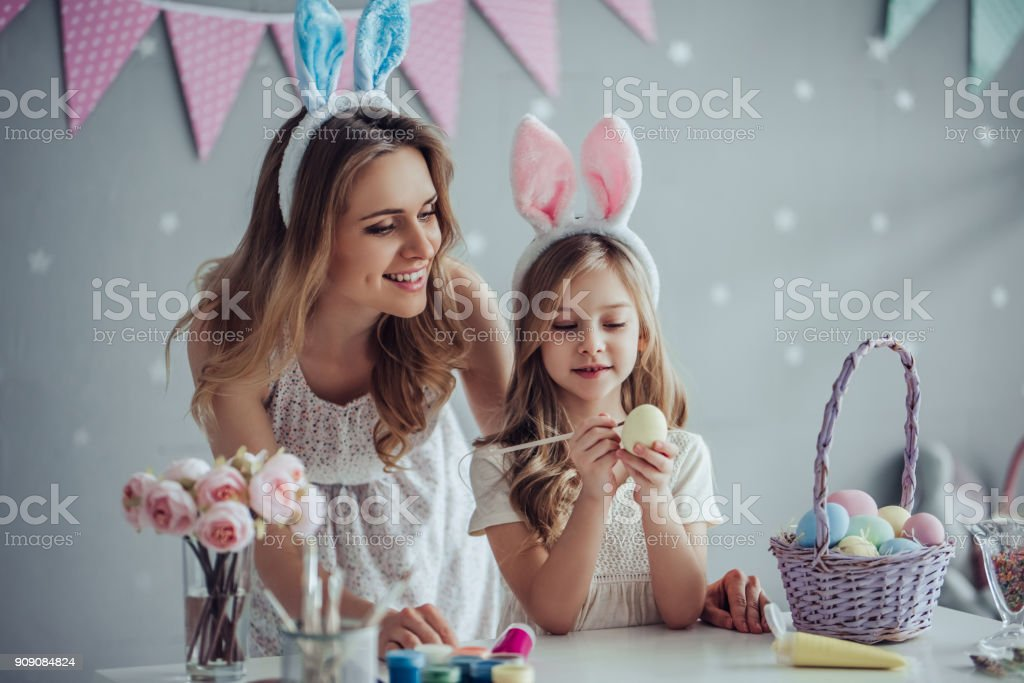 Mom and daughter preparing for Easter celebration stock photo