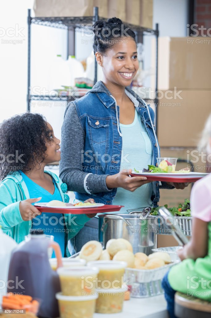 Mid adult mother and her elementary age daughter receive a healthy...