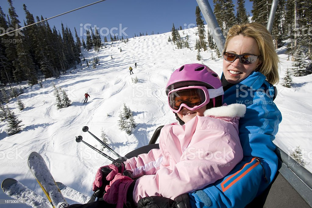 Mom and daughter skiing royalty-free stock photo