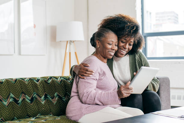 Mom and  daughter together online stock photo