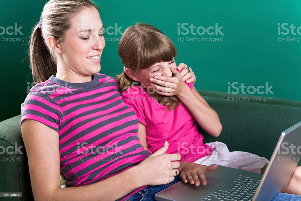 Mom and daughter with laptop royalty-free stock photo