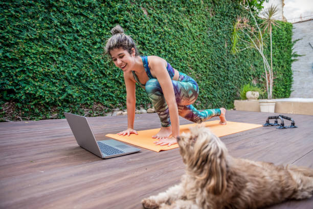 mom and dog exercise together - exercise at home stock pictures, royalty-free photos & images
