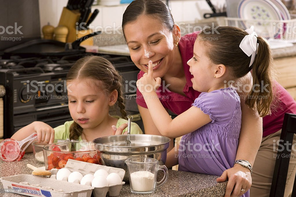 Mom and Girls Baking a Cake royalty-free stock photo