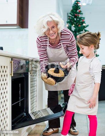 istock Mom and grandaughter are preparing  cake for Christmas - Kugelhupf 494086398
