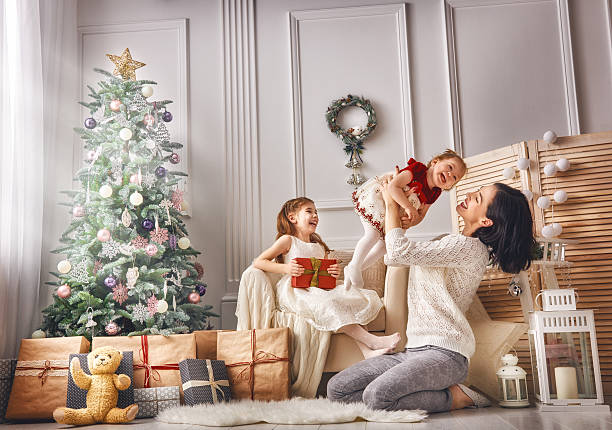 mom and her cute daughters - christmas gift family bildbanksfoton och bilder