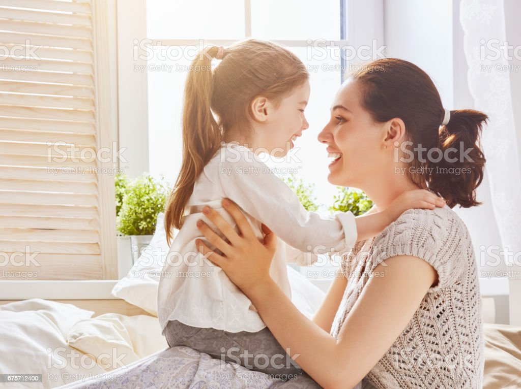 Mom and her daughter are playing 免版稅 stock photo