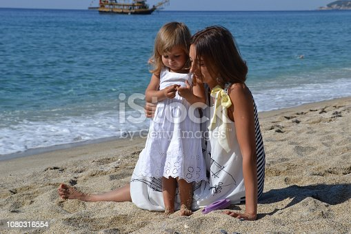 istock Mom and her little daughter playing together 1080316554