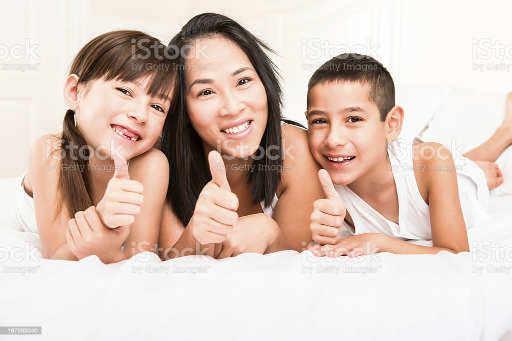Mom and kids giving thumbs up royalty-free stock photo