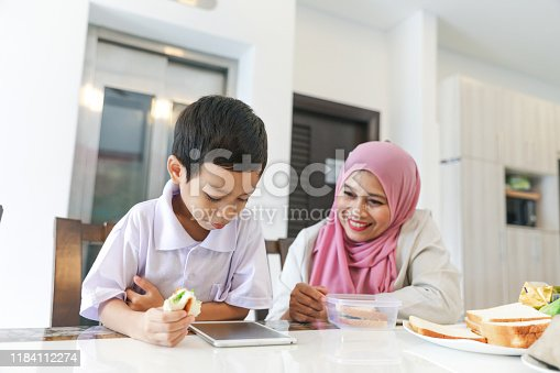 1151176639 istock photo Mom and kids preparing to go to school 1184112274