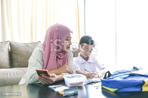 1151176639 istock photo Mom and kids preparing to go to school 1184112312
